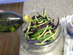 Place in a bowl and pour about 1/4 cup of olive oil on them. Toss until completely coated. DO NOT SEASON YET!
