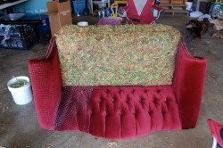 Time to flip over the love seat. This made doing the back much easier, so as not to have to fight with falling peat moss when trying to sew the tufts of moss in place.